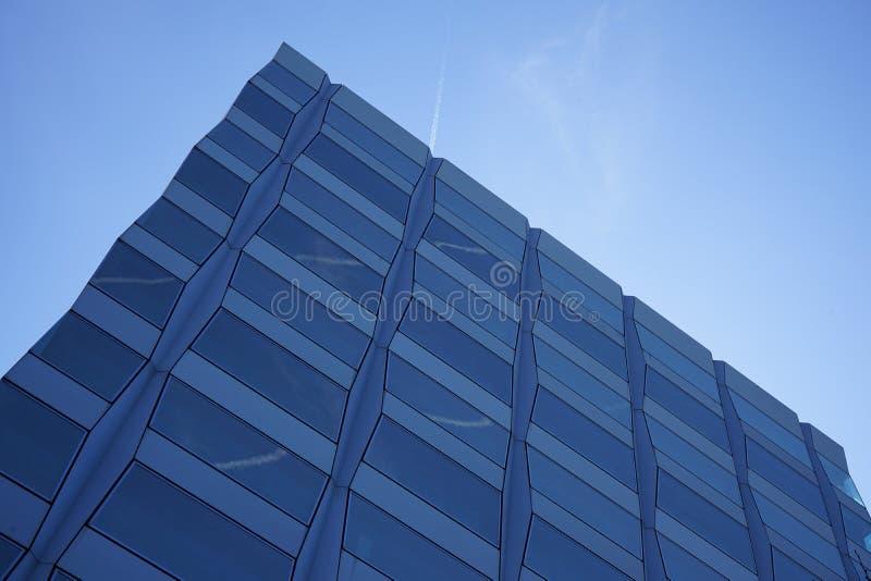 Corner of modern building in blue skies stock image