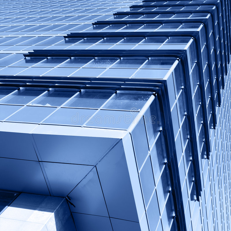 Corner of modern office building. Toned in blue color royalty free stock photo