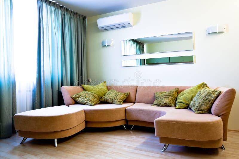 Corner in modern studio with sofa stock images