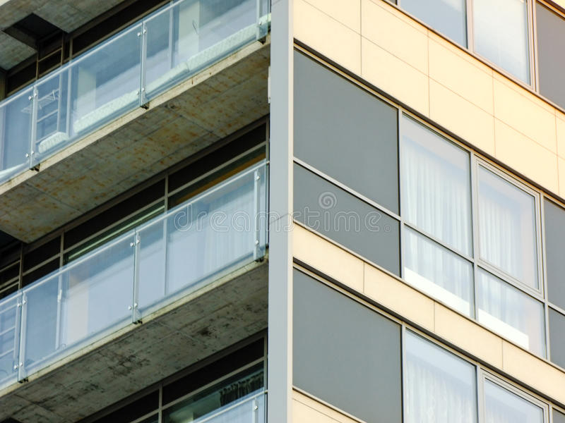 Corner of new modern Building. Corner of new modern glass and concrete Building with Balcony in Vilnius City, Lithuania stock image