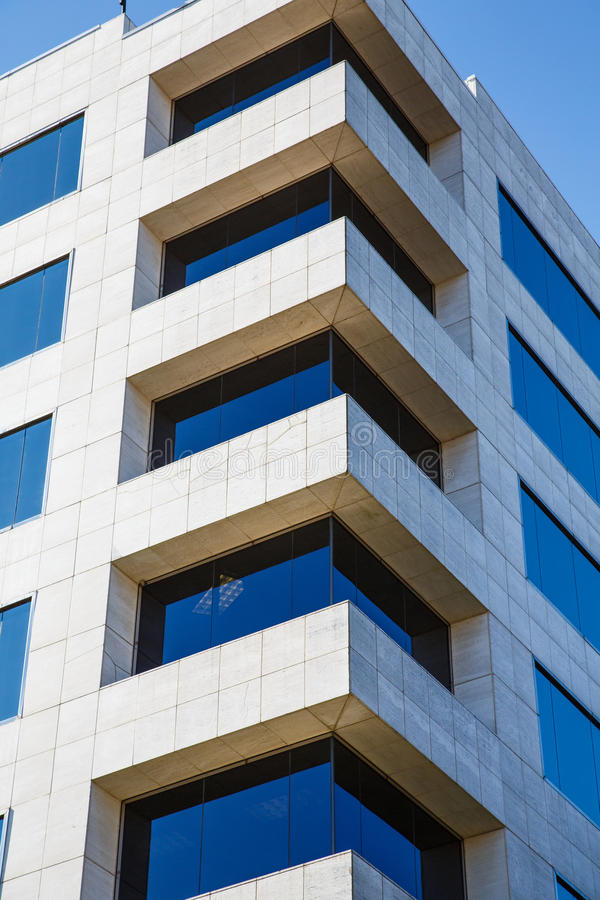 Free Corner Of White Marble Building With Blue Glass Windows Royalty Free Stock Photo - 30284345