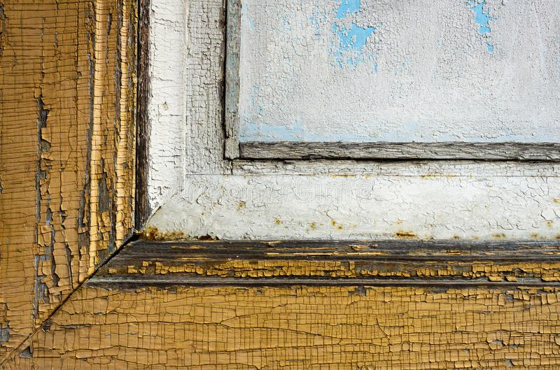 Old wooden window frame with peeling yellow and white paints, retro, vintage royalty free stock photo