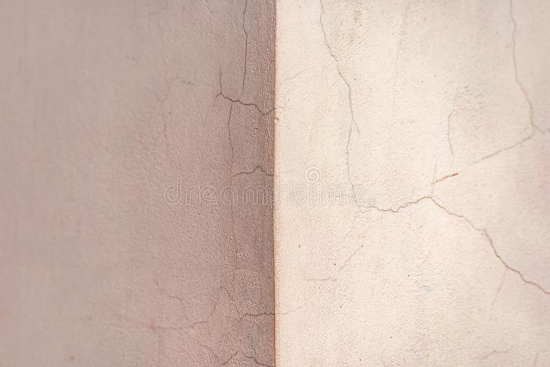 The corner of the pink wall in the cracks stock images