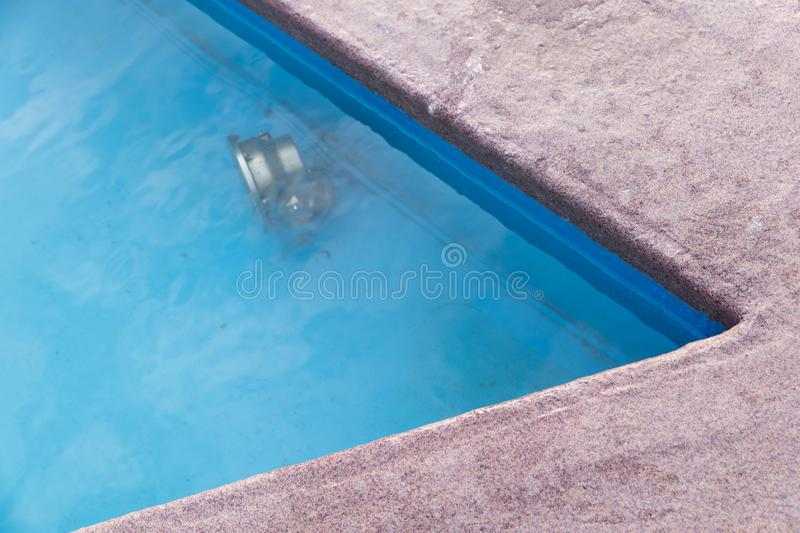 Corner of pool with spotlight under water royalty free stock images