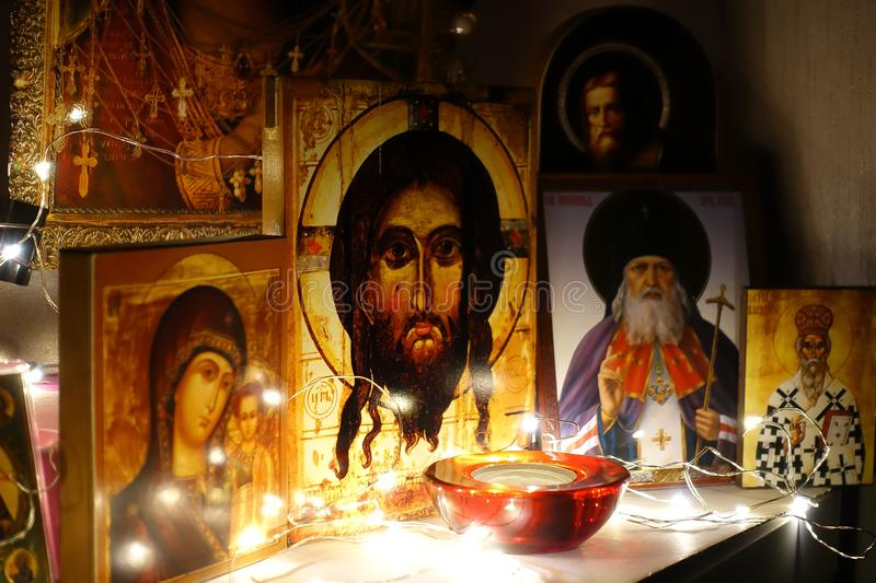 Corner for prayer. Russian traditional home church. Prayer to God. Icons illuminated by a garland. Jesus Christ. Ancient orthodox royalty free stock photo