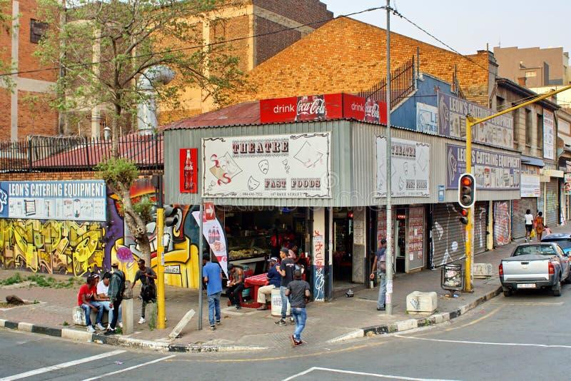Corner restaurant in Newtown. Restaurant on a corner, with a busy sidewalk in front, in Newtown, Johannesburg, South Africa stock photos