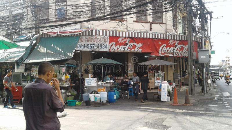 The corner restaurant in a principal street in the city of Bangkok. royalty free stock photo