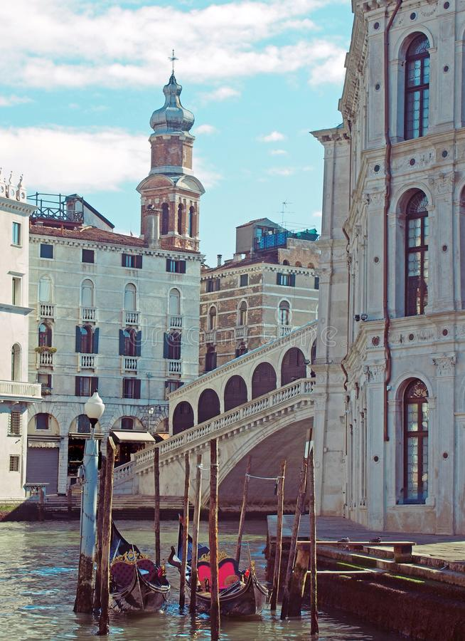 Corner the rialto area of central venice on a sunlit morning with gondolas moored next to the grand canal and old buildings royalty free stock photos