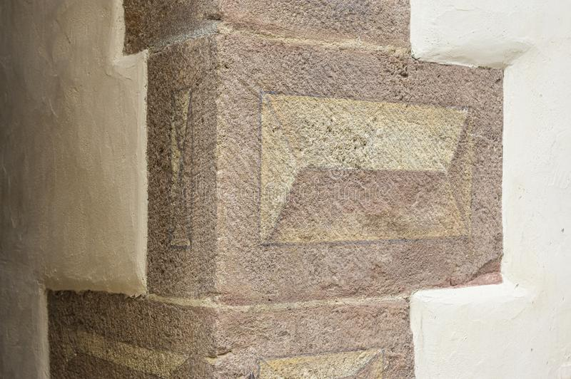 Corner stones painted as Bossensteine with a three-dimensional motif on a beautifully restored old house stock images