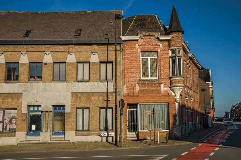 Corner street with brick houses at sunset in Tielt. stock photography