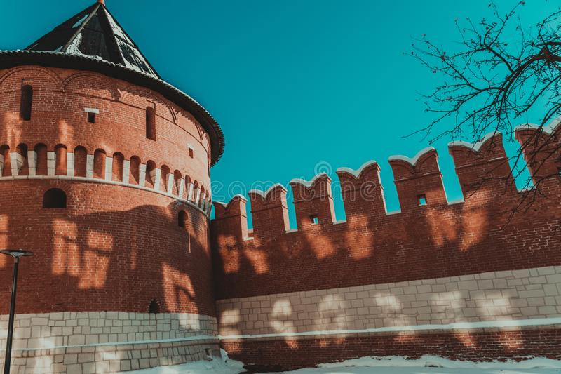 Corner  tower of the Tula Kremlin against the blue sky and part of the brick wall. stock photography