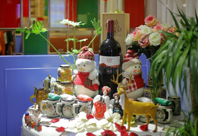 Corner of Hungarian restaurant, adobe rgb. Corner of ungarian restaurant in zhonghuacheng mall, xiamen city, china. there are wine, doll, deer, cup, rose vase royalty free stock photo