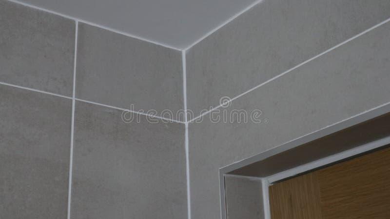 Corner view of grey tiles in a bathroom stock photos