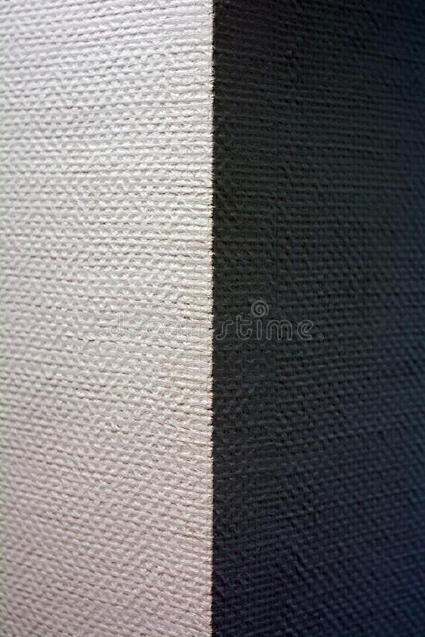 Corner of the wall with a texture, on one side lit, on the other - no royalty free stock images