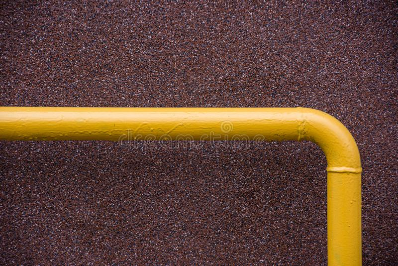 Corner of a yellow metal pipe royalty free stock photography