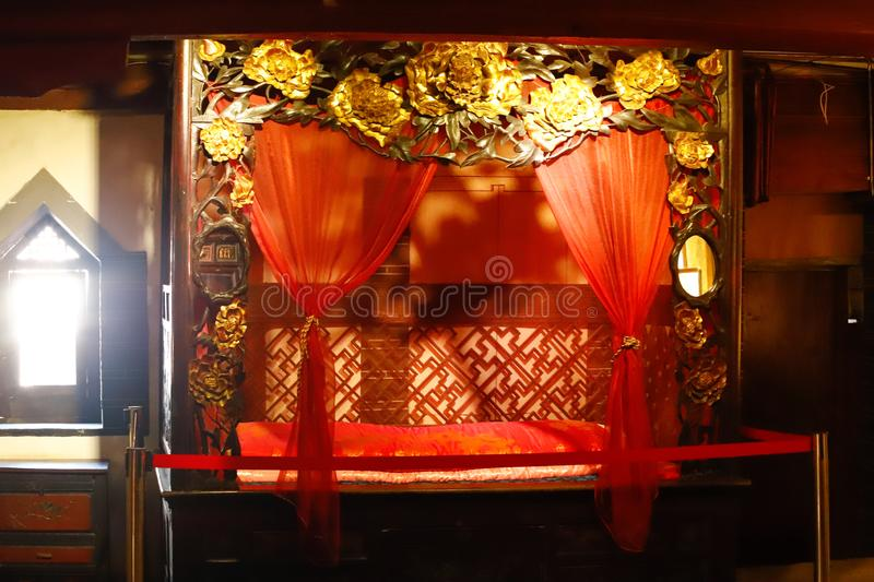 Corners of old China. A decorated bed in an old house in the historic center of Xizhou, Yunnan, China. Xizhou, Yunnan, China royalty free stock photo