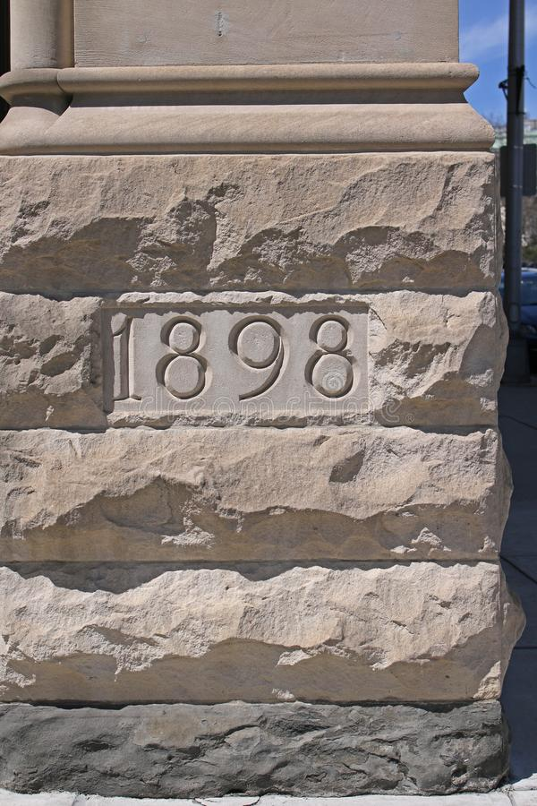 Cornerstone marker on historic building. Cornerstone marker on 1898 historic building in New York State`s capital city, Albany, New York royalty free stock image