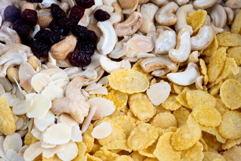 Cornflake cashew almond raisin cereal breakfast food. Texture of background cornflake cashew almond raisin cereal breakfast food royalty free stock images