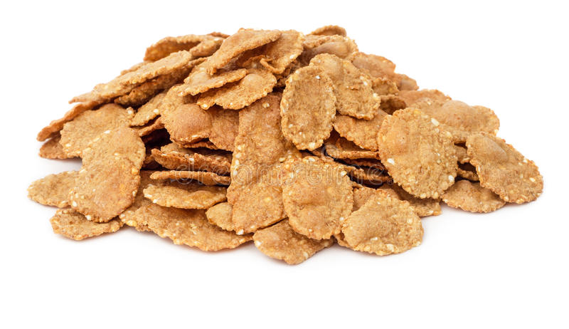 Cornflake cereals isolated. Pile of cornflake cereals isolated on white background royalty free stock images