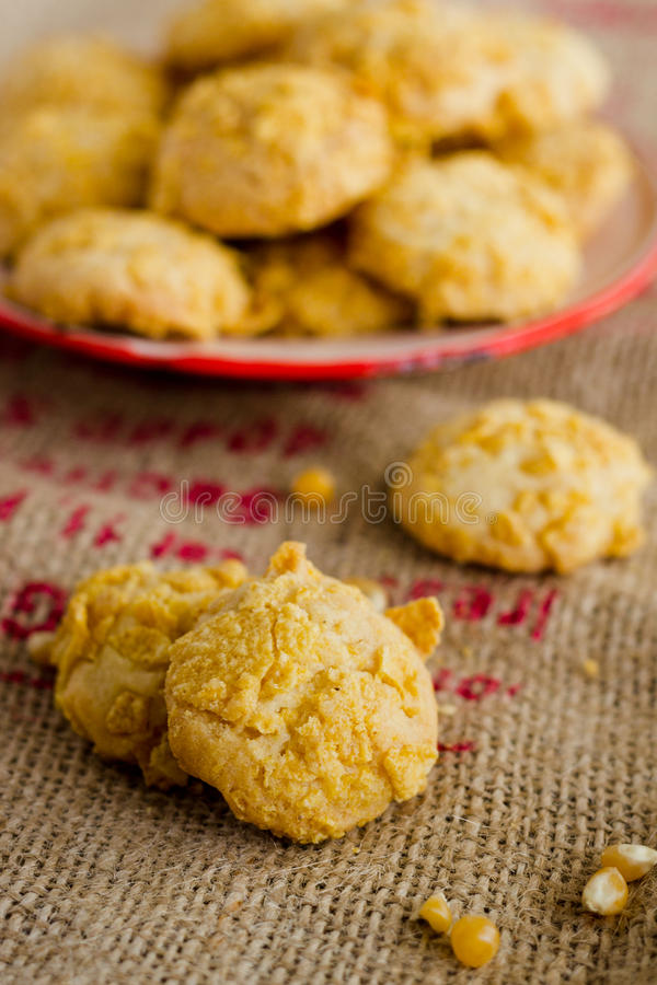 Cornflake Cookies. On burlap with red plate in background royalty free stock photos