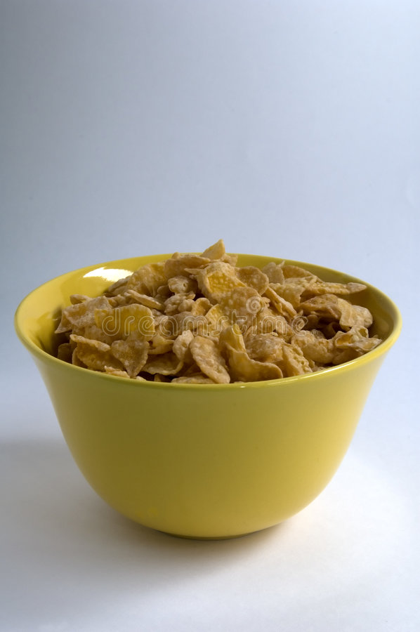 Cornflakes. Some cornflakes in a yellow bowl royalty free stock photography