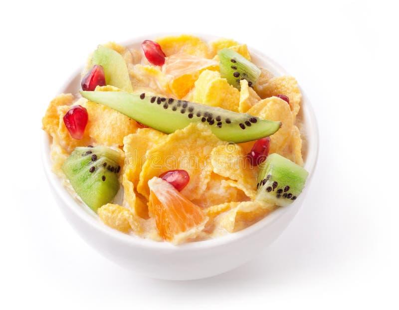 Cornflakes en vruchten in kom royalty-vrije stock foto