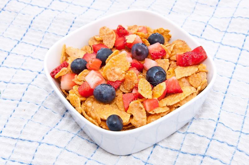 Cornflakes With Fresh Fruits On A Tablecloth Royalty Free Stock Image