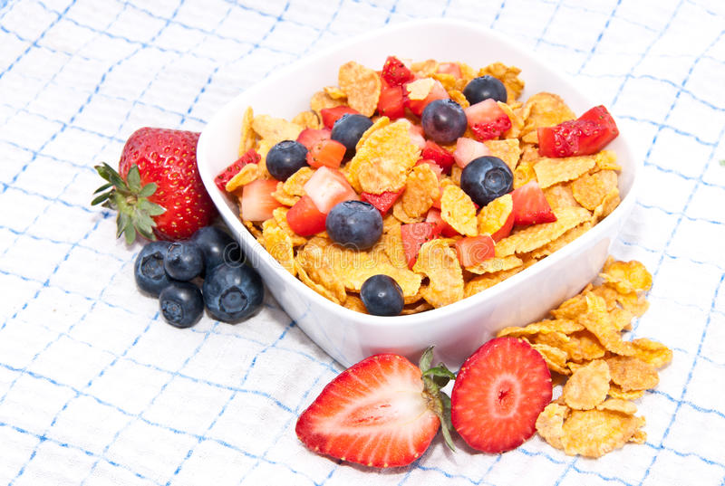 Download Cornflakes With Fresh Fruits On A Tablecloth Stock Image - Image: 25313607