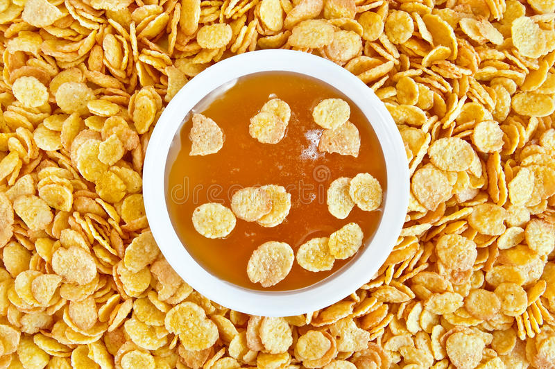 Cornflakes with honey stock images