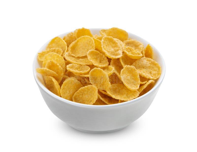 Cornflakes in kom op witte achtergrond wordt ge?soleerd die stock afbeeldingen