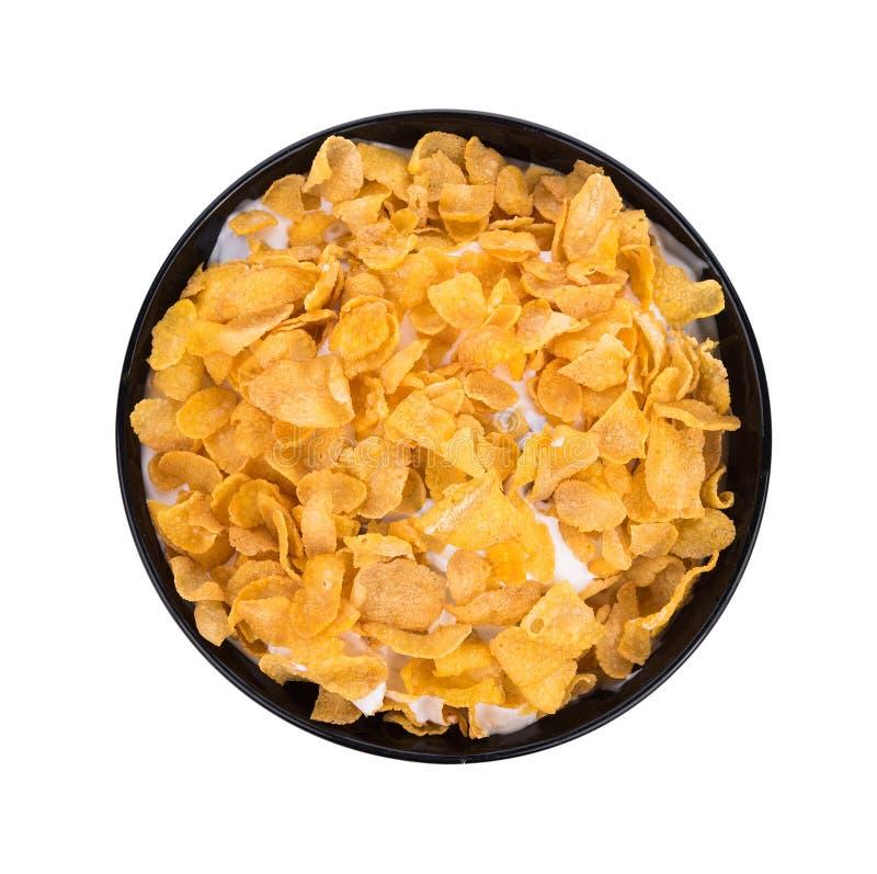 Cornflakes met melk die op witte achtergrond wordt geïsoleerd royalty-vrije stock afbeeldingen