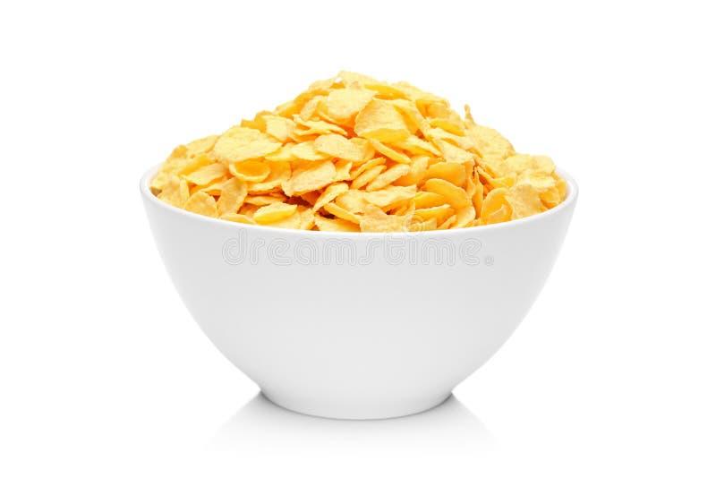 Cornflakes in porseleinkom stock foto's