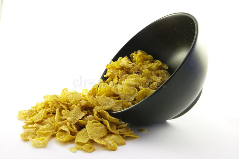Download Cornflakes Spilling Out Of A Bowl Stock Photo - Image of fresh, nutrition: 10671954