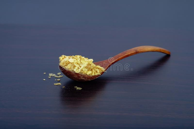 Cornflakes in wood spoon on a dark wooden. Background and copy space stock photography