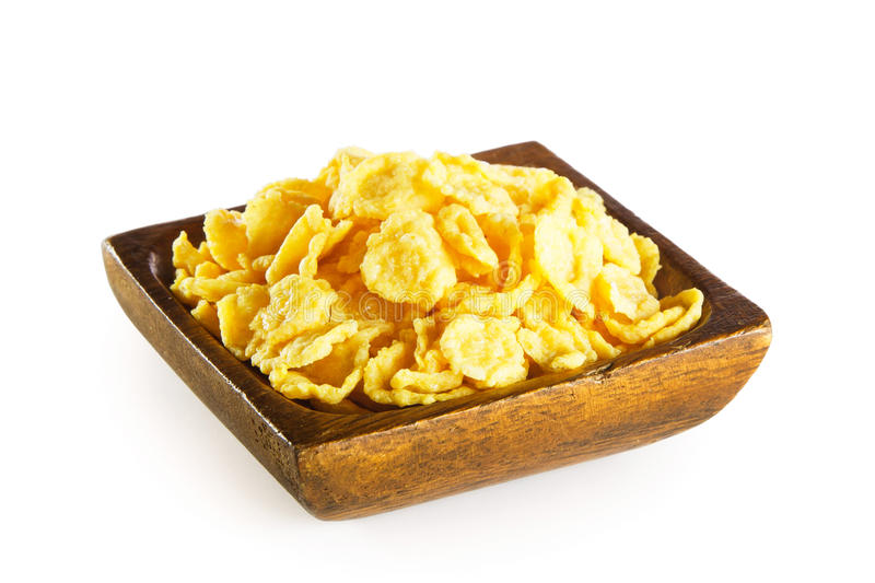 Cornflakes in wooden bowl royalty free stock images
