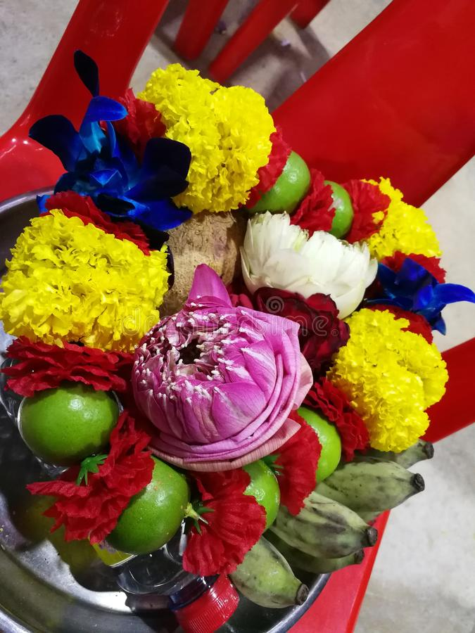 Flowers, marigolds, lotus, banana, coconut or fruit for the worship in Thailand Temple at Happy new year cerebation. Cornflowers, marigolds, lotus, banana royalty free stock photo