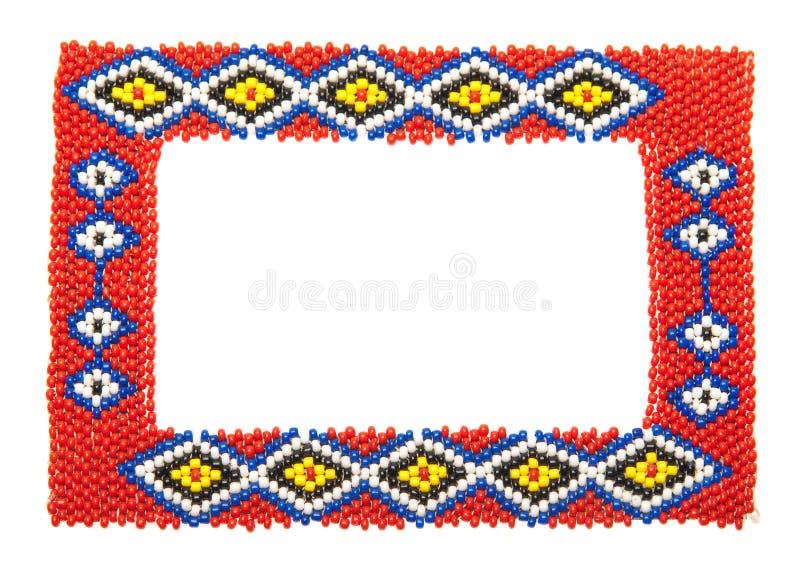 Cornice africana in rilievo isolata su bianco immagine stock