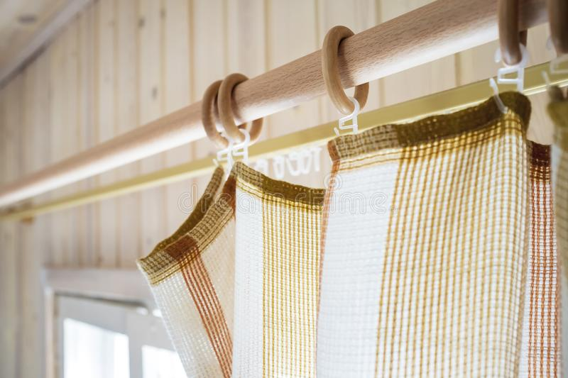 Cornice and curtains in a country house on a background of the w. Alls and windows. Close-up royalty free stock photo