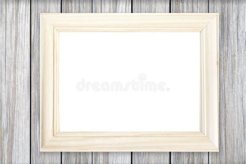 Cornice di legno bianca sulla parete di legno fotografia stock libera da diritti