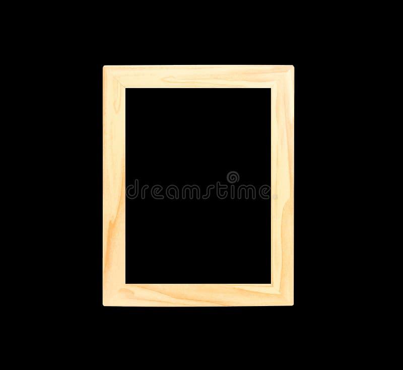 Cornice di legno marrone chiaro isolata su fondo nero con il percorso di ritaglio immagine stock