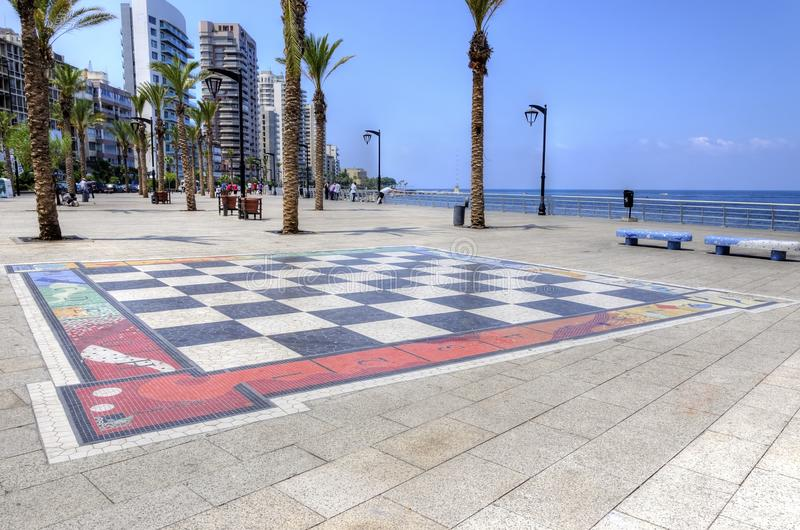 Corniche Beirut, Lebanon. A view of the Corniche Beirut, in Lebanon, and the giant chess board painted on the floor. A paved street lined with palm trees perfect stock photography