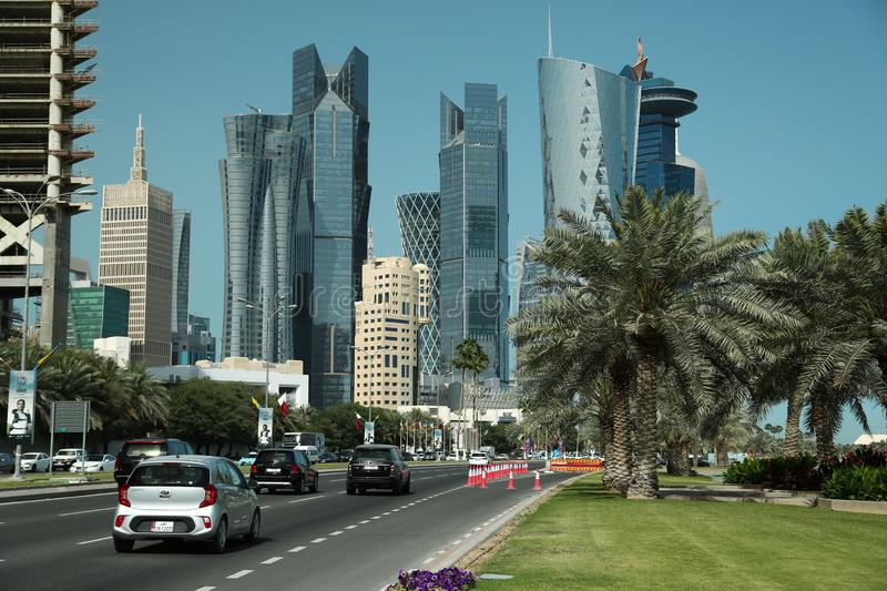 Corniche embankment in financial district in Doha, Qatar. QATAR, DOHA, MARCH 20, 2018: Corniche road and financial centre in Doha city, Qatar. View on stock images