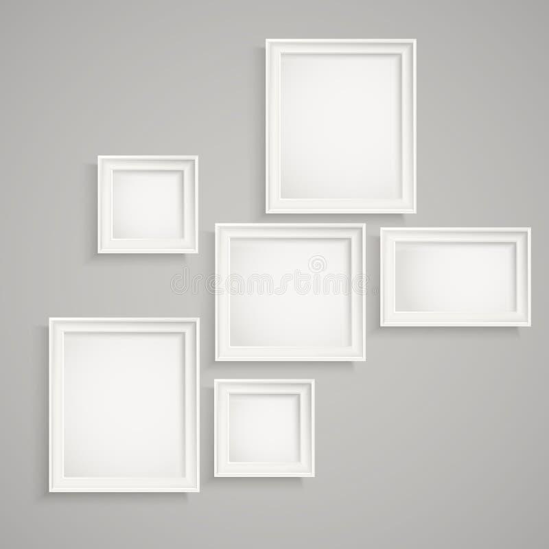 Cornici differenti sulla parete royalty illustrazione gratis