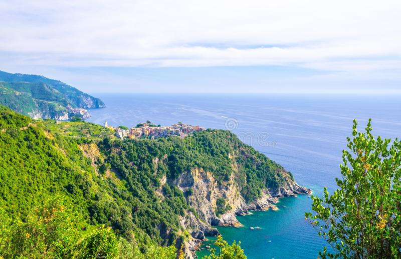Corniglia traditional typical Italian village with colorful buildings on rock cliff and Manarola stock photo
