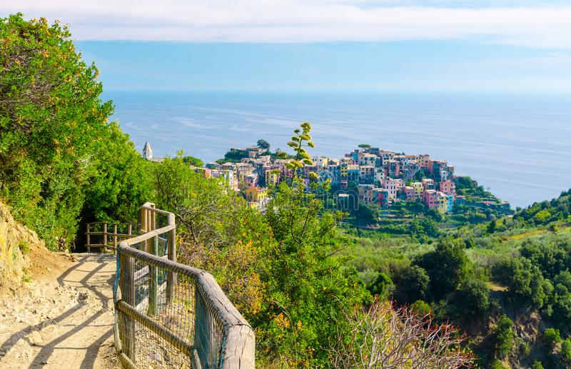 Corniglia traditional typical Italian village with colorful multicolored buildings houses on rock cliff and Genoa Gulf, Ligurian S royalty free stock photo