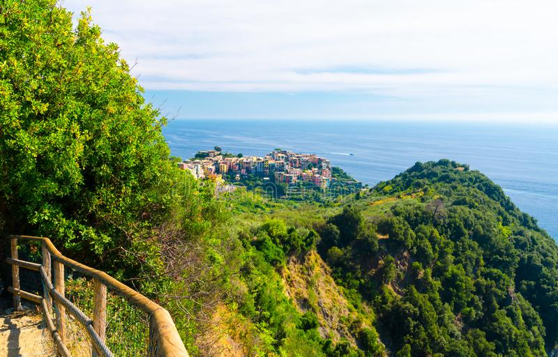 Corniglia traditional typical Italian village with colorful multicolored buildings houses on rock cliff and Genoa Gulf, Ligurian S stock images