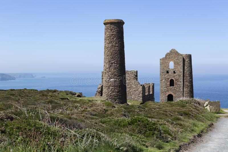 Cornish tin mine on the edge of the cliffs in Cornwall,UK. Old cliff top Cornish tin mine situated on the South West coast path in Cornwall, UK royalty free stock photos