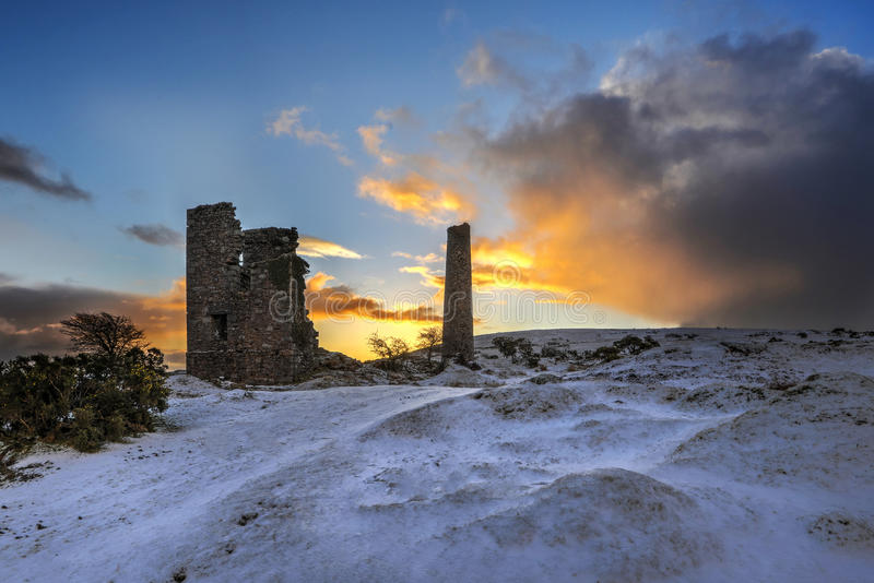 Cornish Tin mine at sunrise, Caradon, Cornwall, UK. Cornish Tin mine at sunrise, with snow, Caradon Hill, Cornwall, UK royalty free stock image
