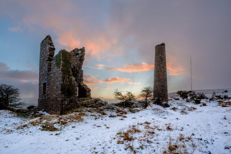 Cornish Tin mine. At sunrise in the snow stock image