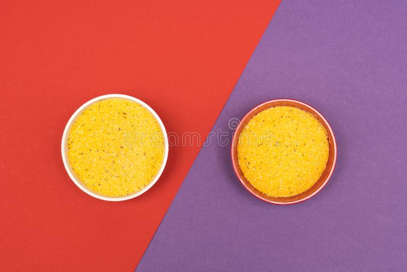 Cornmeal a bowl. On a colored background royalty free stock photos